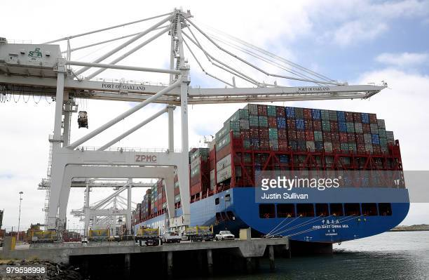 The Hong Kong based CSCL East China Sea container ship sits in a berth at the Port of Oakland on June 20 2018 in Oakland California US president...