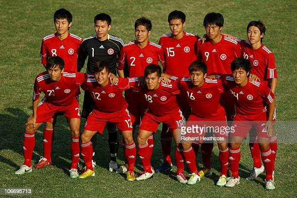 The Hong Kong team pose for the cameras prior to kickoff during the Men's Football Group E pool match between Hong Kong and Bagladesh ahead of the...