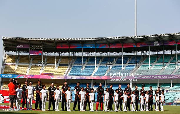The Hong Kong team stand for their National Anthem during the ICC Twenty20 World Cup Group B match between Zimbabwe and Hong Kong at the Vidarbha...