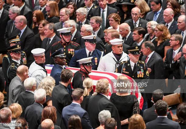 The Honor Guard carries in the casket at the start of the funeral service at the National Cathedral for Sen John S McCain a sixterm senator from...