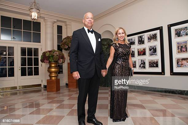 The Honorable Jeh Johnson Secretary of Homeland Security US Department of Homeland Security and Dr Susan DiMarco arrive at the White House in...