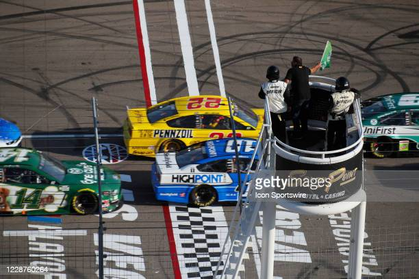 The honorary starter waves the green flag to start the South Point 400 NASCAR Cup Series Playoff Race on Sept. 27, 2020 at Las Vegas Motor Speedway...