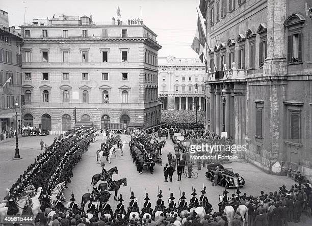 The honour guard in front of Palazzo Montecitorio welcoming the arrival of the provisional Head of State of Italy Enrico De Nicola on the occasion of...