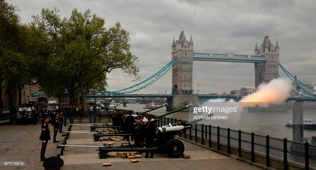 The Honourable Artillery Company fire a 62 gun salute against a backdrop of London's Tower Bridge, on April 21, 2017, as Britain's Queen Elizabeth II celebrates her 91st birthday. Britain marked the 91st birthday of Queen Elizabeth II, with the world's longest-reigning monarch. /