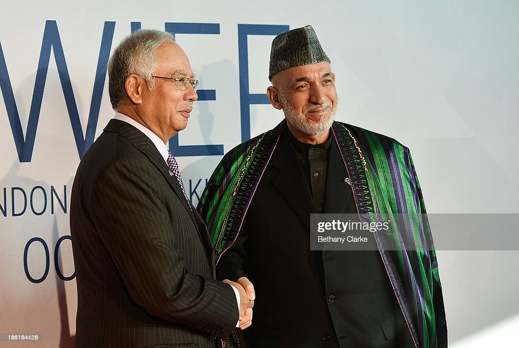 The Honourable Dato' Sri Mohd Najib Tun Abdul Razak, Prime Minister of Malaysia & Patron, WIEF Foundation greets H.E. Hamid Karzai, President of the Islamic Republic of Afghanistan arrives at the 9th World Islamic Economic Forum at ExCel on October 29, 2013 in London, England.
