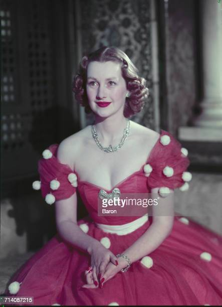The Honourable Mrs Gerald Legge later known as Comtesse de Chambrun and Raine Spencer Countess Spencer wearing an offtheshoulder gown London 1953 She...