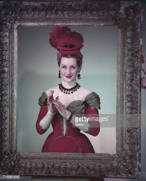The Honourable Mrs Gerald Legge later known as Comtesse de Chambrun and Raine Spencer Countess Spencer wearing Edwardian period costume and posing...