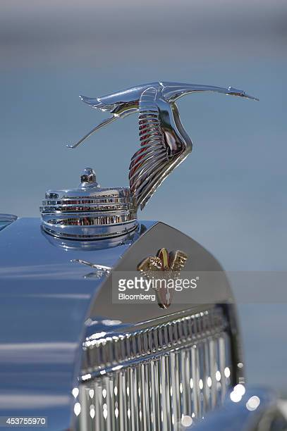 The hood ornament of a 1935 HispanoSuiza K6 Fernandez et Darrin Coupe Chauffeur sits on display during the 2014 Pebble Beach Concours d'Elegance in...