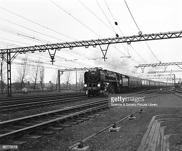 """The """"Hook Continental"""" pulled by a 7MT class 4-6-2 locomotive number 70042 """"Lord Roberts"""" at Shenfield, Essex, 14 April 1958. This train took..."""