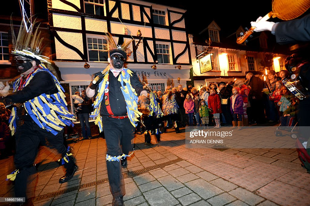 The Hook Eagle Morris Men dance outside the Waggon and Horses pub during the annual Wassail night in Hartley Wintney, 40 miles (64 Kilometers) west of London, on January 4, 2013. The event, held near to twelfth night, celebrates both the passing of Christmas and the future good health of the fruit trees. Traditionally the custom involved the local farm workers visiting the orchard after dark with shotguns, horns, food and a large pail of cider. They would make a loud noise to raise the Sleeping Tree Spirit and to scare off demons. Cider would be poured over the roots and pieces of toast placed in the branches as a gift to the spirit of the tree. The wassail song is sung as a blessing or charm to bring fruitfulness or even in admonishment not to fail in the upcoming year.