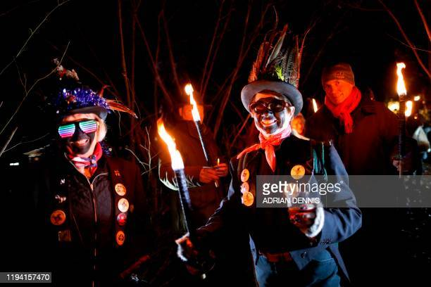 The Hook Eagle Morris Men make their way to the orchard to sing to the apple trees during the annual Wassail night in Hartley Wintney 40 miles west...