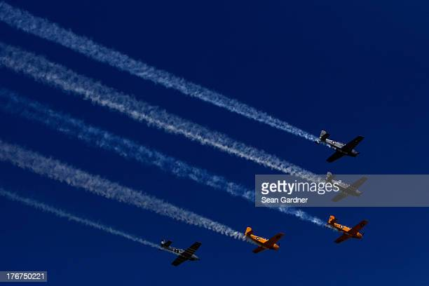 The Hooligan's Flight Team perform a flyby in their T34 aircraft during prerace ceremonies for the NASCAR Sprint Cup Series 44th Annual Pure Michigan...