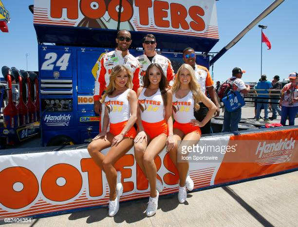 The Hooters girls pose with some of the team crew members prior to the Monster Energy NASCAR Cup Series race on May 7, 2017 at Talladega...