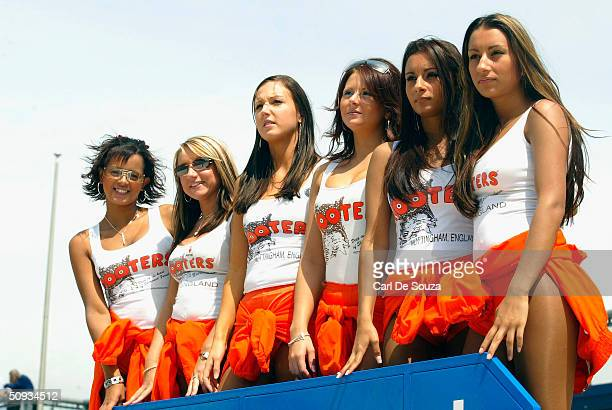 "The Hooters pit girls watch the ""Days of Thunder"" motorsport event, following a day of racing, at the Rockingham Motor Speedway, Corby on June 6,..."