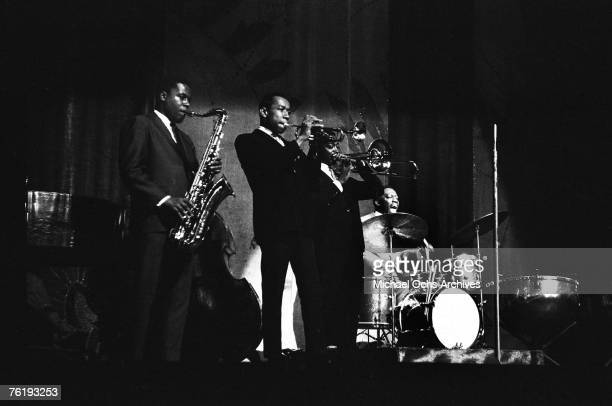 The horn section of saxophonist Wayne Shorter trumpeter Freddie Hubbard and trombonist Curtis Fuller blow their chorus while bandleader/drummer Art...