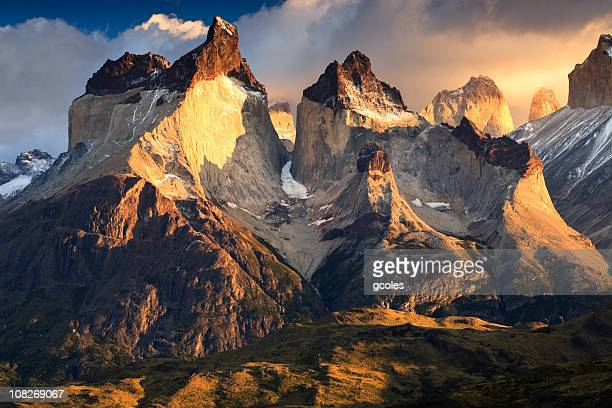 los cuernos del paine mountains at sunrise - torres del paine national park stock photos and pictures