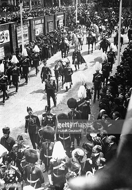 The horse and dog Caesar belonging to the late King Edward VII form part of his funeral procession as it nears Paddington Station in London watched...