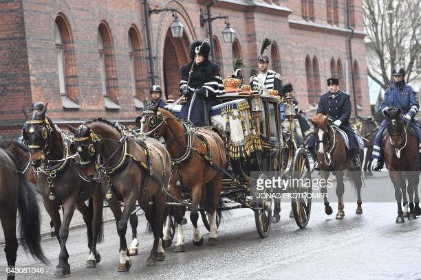 The horse carriage carrying King of Sweden Carl Gustaf Queen Silvia of Sweden Governor General of Canada David Johnston and his wife Sharon Johnston...