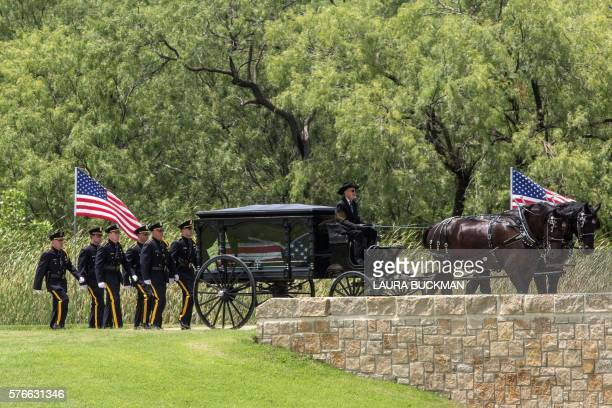 The horse drawn hearse of Dallas Police officer Patricio Zamarripa arrives for burial in the Dallas Fort Worth National Cemetery on July 16 in Dallas...