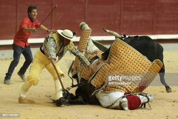 The horse of a picador falls after being hit by a bull during a bullfight at the 'Coliseum Burgos' bullring in Burgos on June 27 2017 / AFP PHOTO /...
