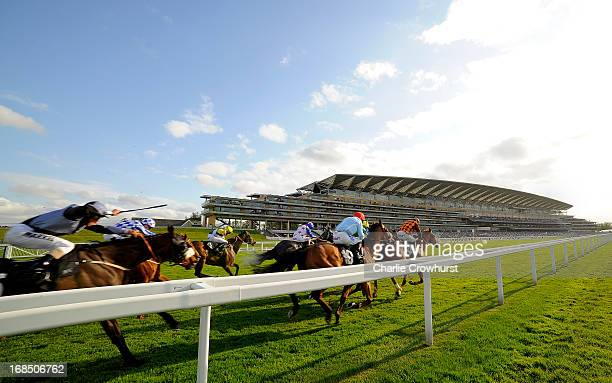 The Horses and Jockeys head past the grandstand during the Two Circles Handicap Stakes at Ascot racecourse on May 10 2013 in Ascot England