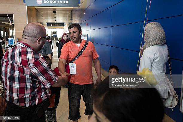 The Hoshan family arrives at the Detroit Metropolitan Airport on July 31 2015 in Detroit Michigan They spent three years as refugees in Jordan and...