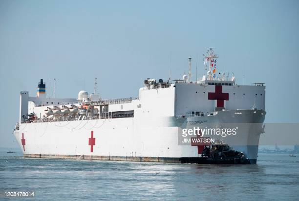 The hospital ship USNS Comfort departs Naval Base Norfolk on March 28 in Norfolk Virginia The Comfort sails to New York City to aid in the...