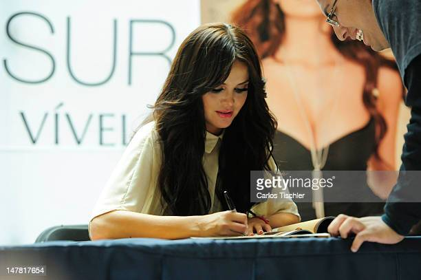 The host and model Marisol Gonzalez signs autographs at Perisur Shopping Mall on July 03 2012 in Mexico City Mexico