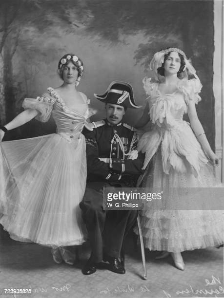 The host and two guests at a fancy dress ball given by Conservative politician Lord Winterton and Mrs F.E. Smith at Claridge's hotel, London, 1910....