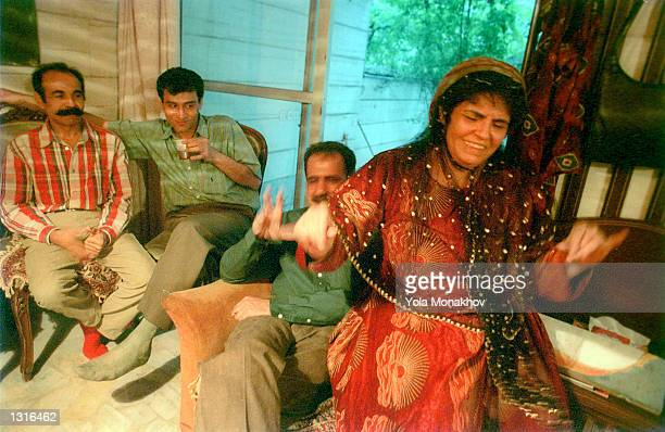 The hostess of a wedding party dances to Persian music for her friends June 11, 2001 at a house in northeastern Tehran in Iran. She is wearing a...