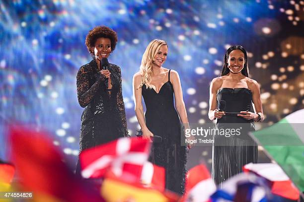 The hosts Arabella Kiesbauer Mirjam Weichselbraun and Alice Tumler perform on stage during the final of the Eurovision Song Contest 2015 on May 23...