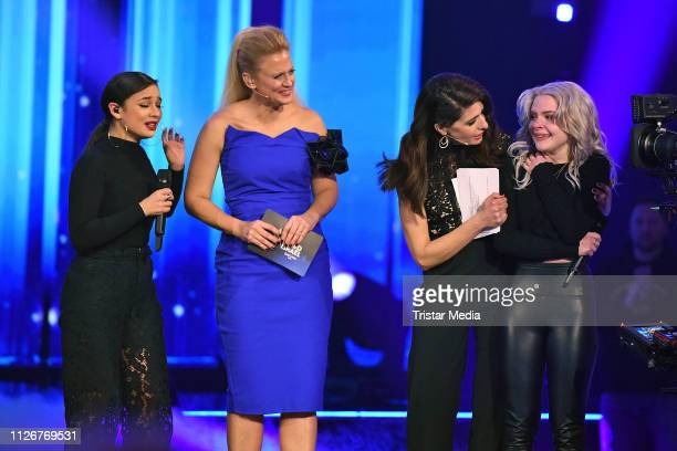 The hosts Barbara Schoeneberger and Linda Zervakis Carlotta Truman and Laurita Spinelli of the duo Ssters after winning the ARD TV show 'Unser Lied...