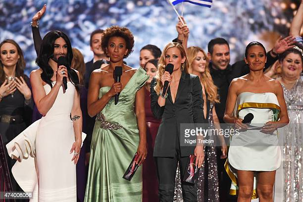 The hosts Conchita Wurst, Mirjam Weichselbraun, Alice Tumler and Arabella Kiesbauer performs on stage during the first Semi Final of the Eurovision...