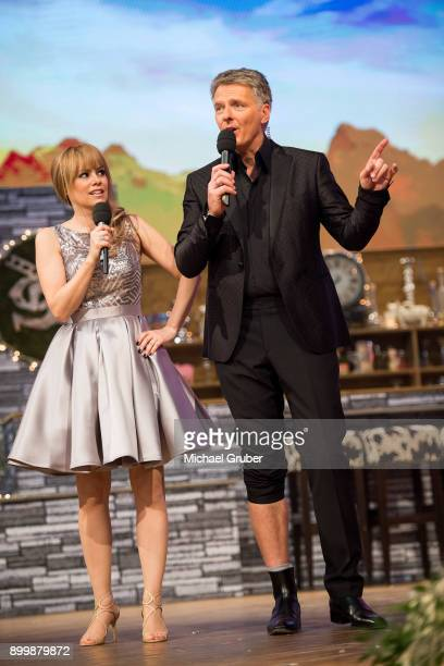 The Hosts Francine Jordi and Joerg Pilawa perform during the New Year's Eve tv show hosted by Joerg Pilawa on December 30 2017 in Graz Austria