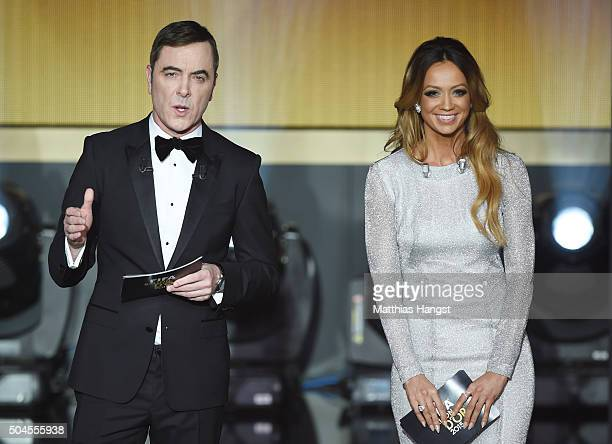 THe hosts James Nesbitt and Kate Abdo pose on stage during the FIFA Ballon d'Or Gala 2015 at the Kongresshaus on January 11 2016 in Zurich Switzerland