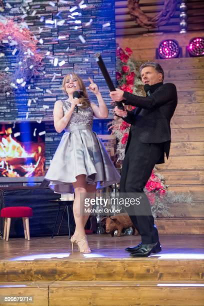 The Hosts Joerg Pilawa and Francine Jordi perform during the New Year's Eve tv show hosted by Joerg Pilawa on December 30 2017 in Graz Austria