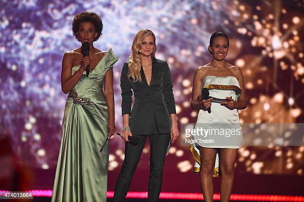The hosts Mirjam Weichselbraun Alice Tumler and Arabella Kiesbauer performs on stage during the first Semi Final of the Eurovision Song Contest 2015...