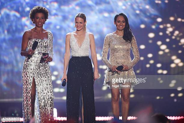The hosts Mirjam Weichselbraun Alice Tumler and Arabella Kiesbauer performs on stage during the second Semi Final of the Eurovision Song Contest 2015...