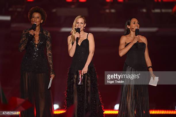 The hosts Mirjam Weichselbraun, Alice Tumler and Arabella Kiesbauer performs on stage during the final of the Eurovision Song Contest 2015 on May 23,...