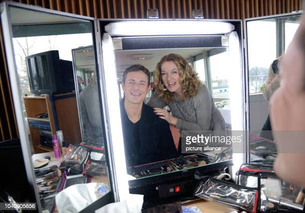 The hosts of the NDR talkshow 'Bettina und Bommes' Bettina Tietjen and Alexander Bommes in front of a mirror at the NDR state broadcasting centre in...