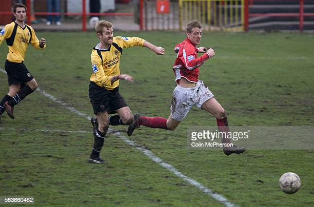 The hosts pressing for an equaliser at the uncovered Derwent end of the ground the Blue Square North fixture between hosts Workington AFC and Boston...