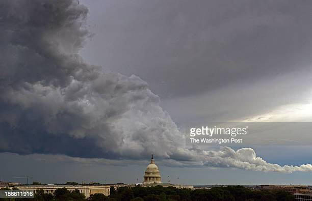 The hotly anticipated storm front passes over the US Capitol dome on its' way through town on June 2013 in Washington DC