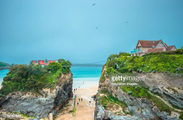The House in the sea is a property accessed across a suspension bridge on Towan beach at Newquay in Cornwall England UK