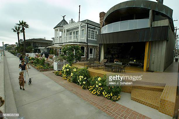 The house is squeezed between two others on the boardwalk of Balboa Island but it gets a lot of attention it is modern almost looks like Darth...