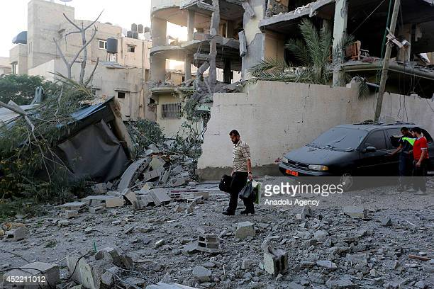 The house of Mahmoud al-Zahar, a co-founder of Hamas and a member of the Hamas leadership in the Gaza Strip, and the surrounding buildings hit during...