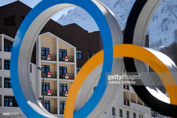 The house of the Swiss athletes is seen through the olympic rings on February 4 2014 at the Mountain Olympic Village at the Rosa Khutor Alpine centre...