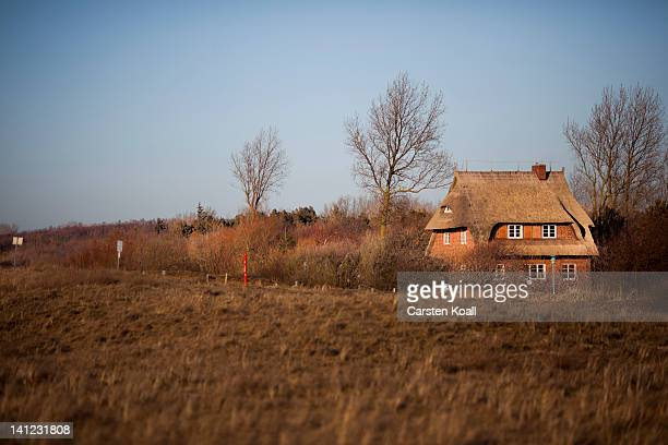 The 'house on the dyke' owned by the family of Joachim Gauck stands on March 12 2012 at Wustrow Germany Gauck spent parts of his holidays in the...