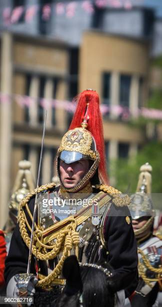The Household Cavalry ride a horse during the wedding ceremony Prince Henry Charles Albert David of Wales marries Ms Meghan Markle in a service at St...