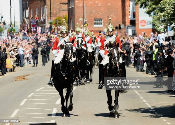 The Household Cavalry ride during the procession as Prince Harry Duke of Sussex and Meghan Duchess of Sussex leave Windsor Castle in the Ascot Landau...