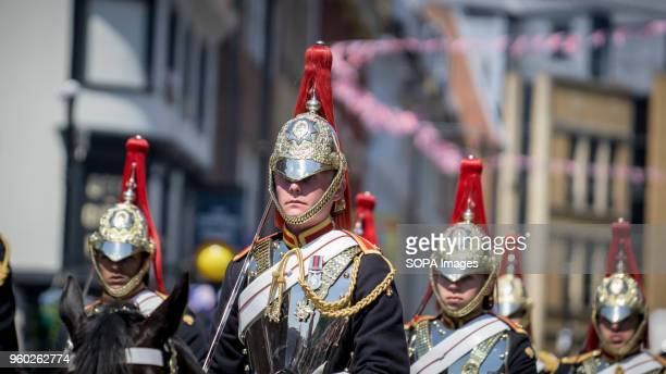 The Household Cavalry ride horses during the wedding ceremony Prince Henry Charles Albert David of Wales marries Ms Meghan Markle in a service at St...